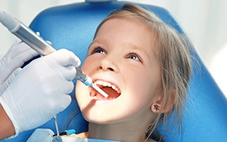 Small child rceiving dental exam