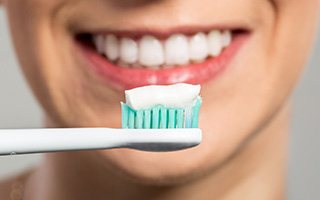Smile and toothbrush with toothpaste